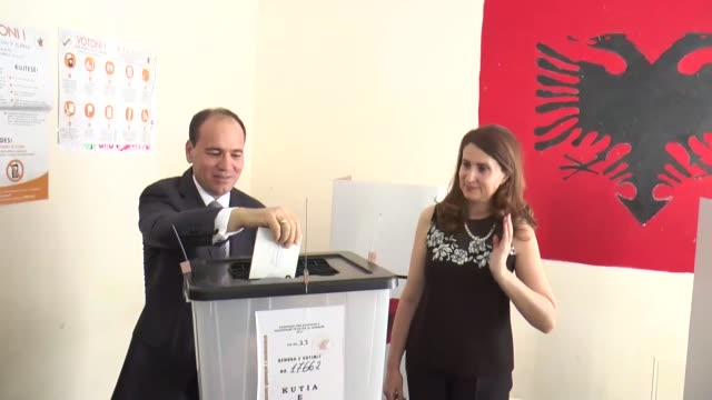 Albanian President Bujar Nishani and his wife Odeta Nishani cast their ballots for parliamentary election at a polling station in Tirana Albania on...