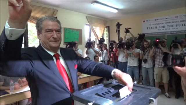 Albania's Prime Minister Sali Berisha cast his vote in national elections Sunday on the morning when a deadly shoot out took place in the northern...