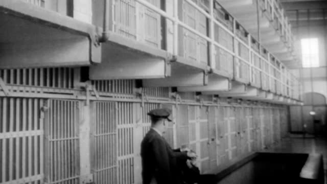 Alcatraz closes for good / view of prison from the bay / men getting onto boat / empty cell block and prison guard / inside a prison cell / prisoners...
