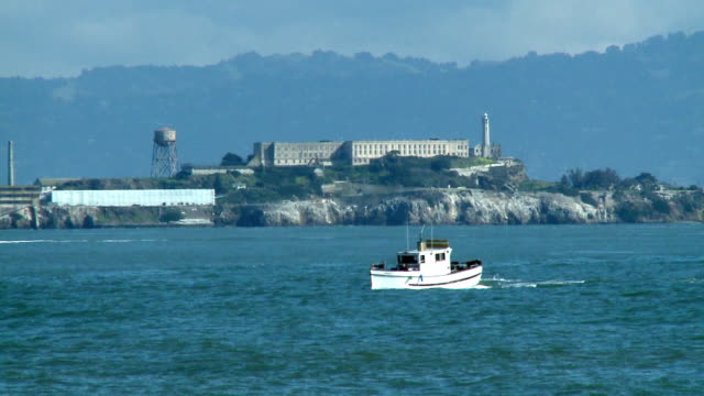 WS, Alcatraz Island, boat crossing bay in foreground, San Francisco Bay California, USA