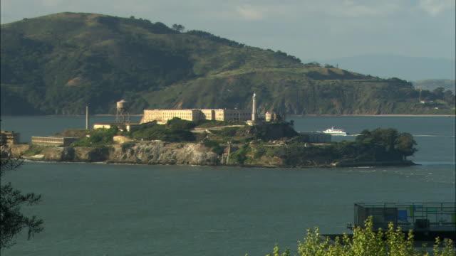 WS Alcatraz island with green hills in background / California, USA