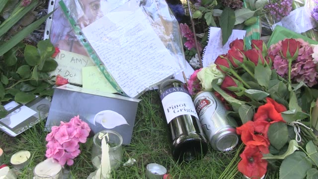 Alcohol and flowers at the Amy Winehouse Death Exterior Shots at London England