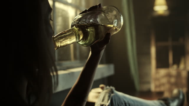 Alcoholic woman drink from bottle