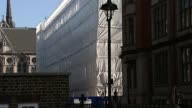Aldwych building partially collapses ENGLAND London Aldwych Serle Street EXT Long shots of scaffolding surrounding partiallycollapsed building with...