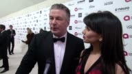 INTERVIEW Alec Baldwin and Hilaria Baldwin on being at the event and on Elton John at the 23rd Annual Elton John AIDS Foundation Academy Awards...