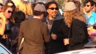 Alejandro Gonzalez Inarritu with award departs the 2015 Spirit Awards in Santa Monica in Celebrity Sightings in Los Angeles