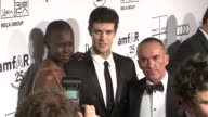 Alek Wek Roberto Bolle and Paolo Diacci at the 2nd Annual amfAR Inspiration Gala New York Arrivals at New York NY