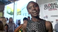 INTERVIEW Alek Wek says it is OUR problem talks about poverty being relevant everywhere because we have the capacity to inspire at 2014 Global...