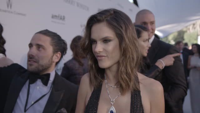 INTERVIEW Alessandra Ambrosio on being at AmfAR on the fashion show on being in Cannes at amfAR's 23rd Cinema Against AIDS Gala Arrivals at Hotel du...