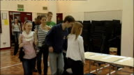 Students collecting results in Buckinghamshire ENGLAND Buckinghamshire Aylesbury INT Exam papers laid out in alphabetical order by student surname on...