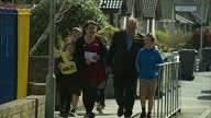 Alex Salmond casts his vote in Gordon Shows exterior shots SNP supporters outside polling station on May 07 2015 in Gordon Scotland
