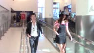 INTERVIEW Alex Turner Arielle Vandenberg talk about One Direction as they depart at LAX Airport in Celebrity Sightings in Los Angeles