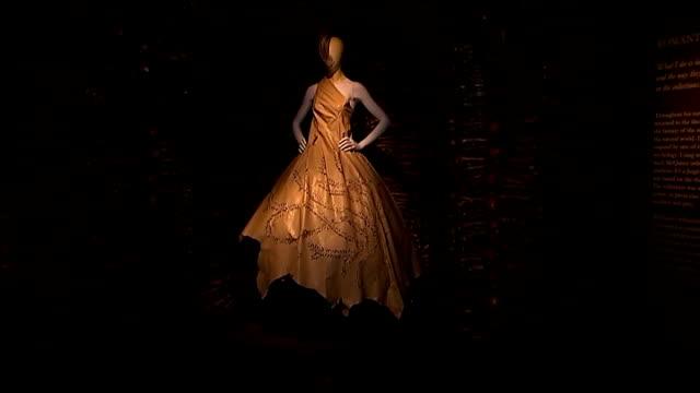 Alexander McQueen exhibition at Victoria and Albert Museum **Music heard intermittently SOT** INT Mannequins on display wearing Alexander McQueen...