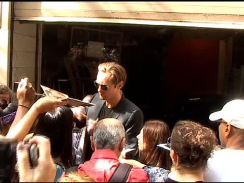 Alexander Skarsgard is surrounded by fans as he departs 'Live with Regis Kelly' in New York 08/03/11