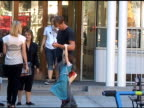 Alexander Skarsgard plays around with his young costar while shooting a film in the West Village in New York 08/12/11