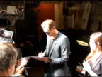 Alexander Skarsgard signs autographs for fans as he departs 'Live with Regis Kelly' in New York 08/03/11