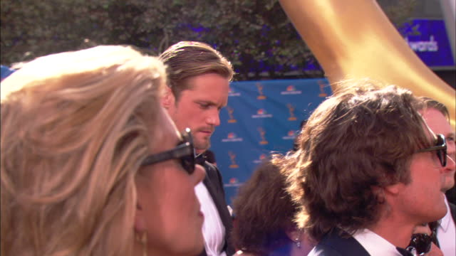 MCU Alexander Skarsgard standing in dense crowd on the red carpet at Nokia theater