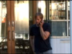 Alexander Skarsgard takes a moment to make a call while shooting a film in the West Village in New York 08/12/11
