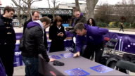Alexandra Burke and Steve Backley attempt to break world record for coin stacking GVs Sign 'London 2012' spelt out in coins Steve Backley posing for...