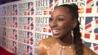 Alexandra Burke on the Brits her dress at the Brit Awards 2012 Red Carpet at the O2 Arena London UK on February 21 2012
