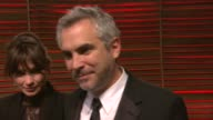 INTERVIEW Alfonso Cuarón at the 2014 Vanity Fair Oscar Party Hosted By Graydon Carter Arrivals on March 02 2014 in West Hollywood California