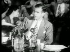 Alger Hiss sitting testifying at House Committee on UnAmerican Activities trials / news