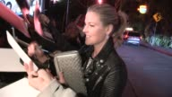 Ali Larter on her baby while greeting fans at the 2013 Vanity Fair And Juicy Couture Celebration in West Hollywood 02/18/13 Ali Larter on her baby...