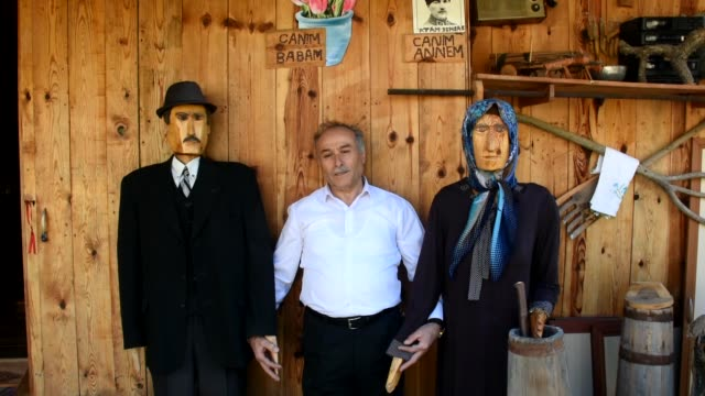 Ali Ulu has placed the lifesized figures in the garden of his house in his family village near the Black Sea and dressed them in his parents' clothes...