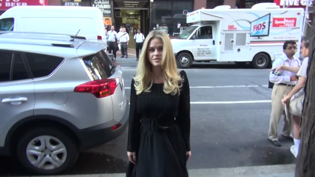 Alice Eve from 'Dirty Weekend' at the 'TODAY' show signs for poses for photos with fans in Celebrity Sightings in New York