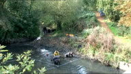 Police investigation to be reviewed ENGLAND London EXT Police divers in River Brent Police team conducting fingertip search of river bank Divers in...