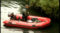 police question second man / canal search ENGLAND London Brentford Lock Grand Union Canal EXT GVs police scuba divers searching Grand Union Canal in...