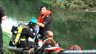 police question second man / canal search ENGLAND London Brentford Lock Grand Union Canal EXT Variosu of police scuba divers searching Grand Union...