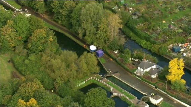 Body found in River Brent AERIAL forensic tents at scene by river Brent where body discovered