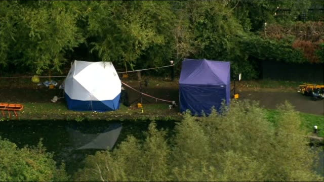 Body found in River Brent AERIAL forensic tents at scene of body discovery along banks of River Brent