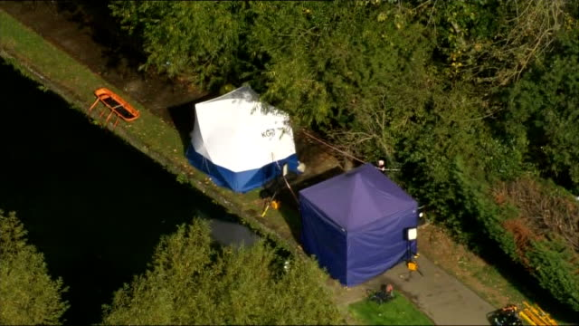 Body found in River Brent Air Views of scene ENGLAND London Hanwell EXT AERIALs police and forensics officers on towpath close to where body of Alice...