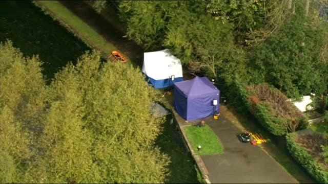 Body found in River Brent ENGLAND London Ealing Hanwell forensic tents at scene of body discovery along banks of River Brent