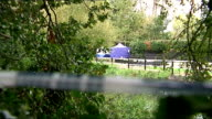 Body found in River Brent Forensic tents in background with police cordon tape in foreground