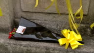 Body found in River Brent Yellow ribbons and floowers at base of clock momunment Close shot bouquet of flowers with yellow ribbon Vox Pop