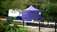 Police hunting suspect Arnis Zalkalns find body T03101402 Ealing Police forensics tents erected on the bank of the River Brent where the body of...