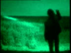 Alien UFO watchers in fields at night / crop circle hoaxer at work in field pushing down crops Crop Circle Hoax on June 23 1994