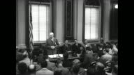 All stand when President Eisenhower and aides enter the room / first announcement the president is getting away for a few hours a short trip with the...