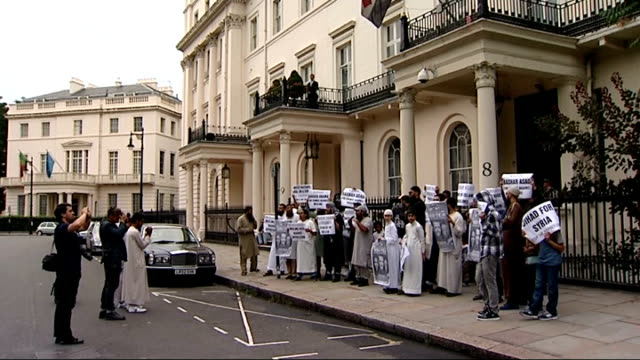 Protest outside Syrian Embassy in London More shots of protesters holding up signs / black and white banner being held up / wide shot group of...