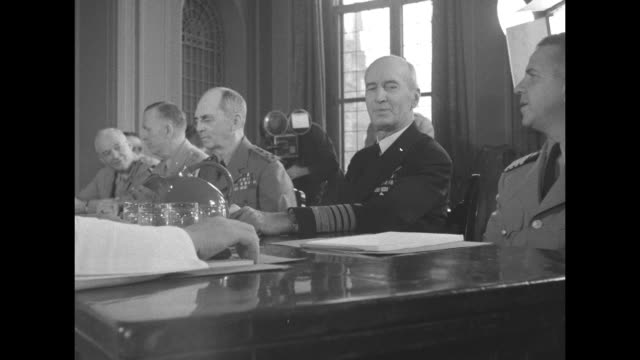 Allied military leaders sitting around table talking US Adm Ernest King Gen Henry Arnold and Gen George Marshall can be seen among others on right...