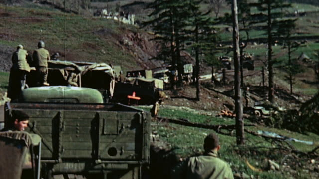 Allied motor transport convoys with trucks Jeeps and motorcycles on crowded narrow mountain roads / Bologna Italy