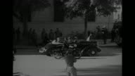 MS Allied soldiers sit atop tank in downtown Tunis / MS Allied soldiers ride past on military truck / VS Allied military parade thru streets of...