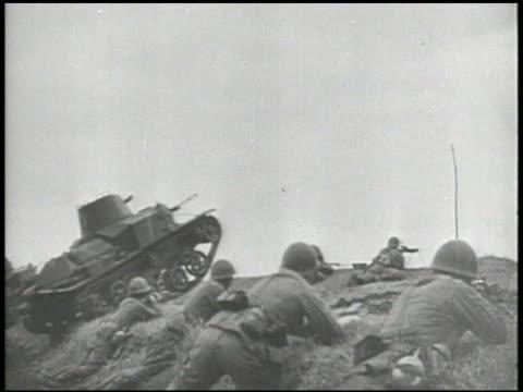 Allied soldiers w/ rifles amp machine guns on stomachs hillside w/ British Vickers light command tank driving over ridge LA WS British machine gun w/...