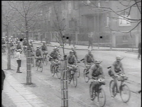 Allied troops marching in formation led by an officer on horseback / Allied troops riding carriages / soldiers riding bicycles / armored vehicles...