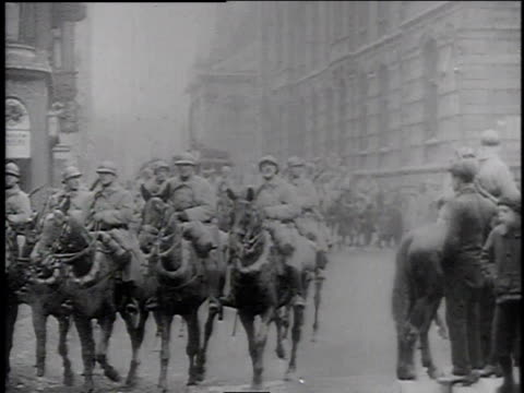 Allied troops ride horses through German streets after the First World War / Germany