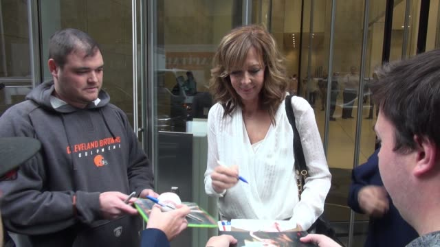 Allison Janney leaving SiriusXM Satellite Radio poses for photos and signs for fans in New York City on November 02 2015 in New York City