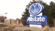 Allstate signage / tighter tilt down of Allstate signage / similar panning and tilting shots of Allstate signage / wide shot of Allstate building and...